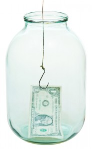 one dollar money and fishhook in glass jar isolated on white background