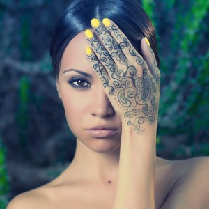 Beautiful young lady with painted hands mehendi