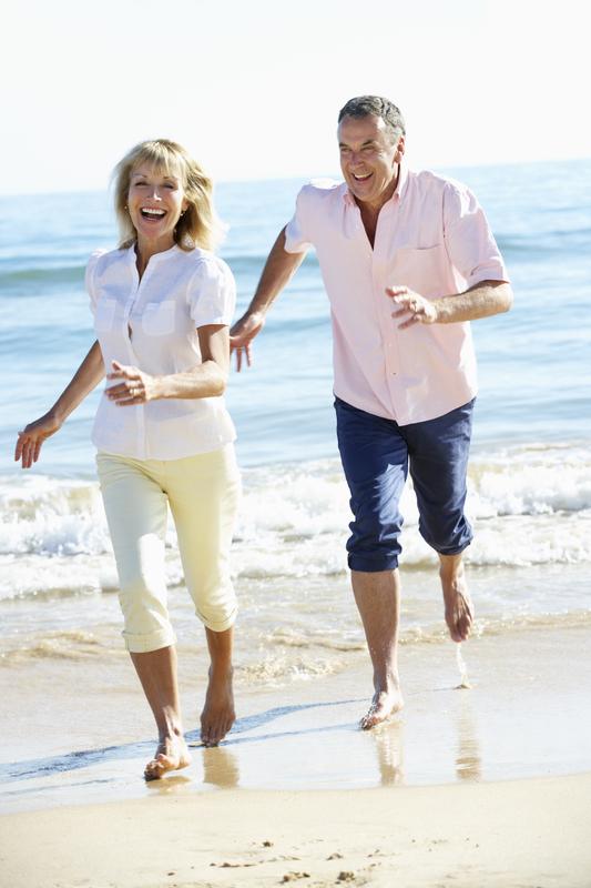 Senior Couple Enjoying Romantic Beach Holiday